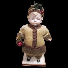 "German All Bisque Winter or Christmas Boy, 7 1/2"" tall"