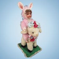 AM 390 painted bisque bunny girl on a plush lamb