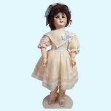 """SFBJ 60 bisque girl, 20"""" french ball jointed body, with original label."""