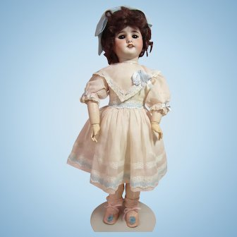 "SFBJ 60 bisque girl, 20"" french ball jointed body, with original label."