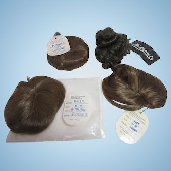 "Four New  doll wigs, Never used, sizes 8"" and 9-10"""