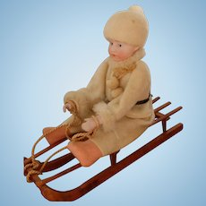 Rare, Wonderful Antique Huebach Doll on Sled Candy Container