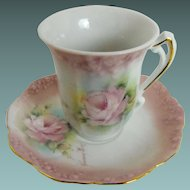 Artist signed chocolate cup and saucer