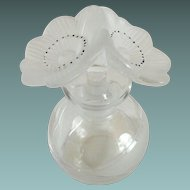 Commercial bottle with frosted double poppy stopper