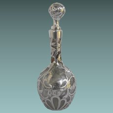 Art nouveau cologne bottle with sterling overlay