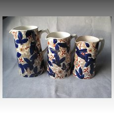 Three Graduated Antique Staffordshire Imari Pitchers