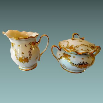 Creamer and Sugar Set with Floral Pattern and Gold Gilt Trim