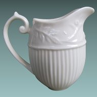 Creamer With Embossed Floral and Ribbed Design By Thatcham Creamware