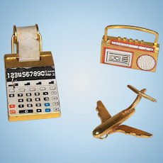 Metal Doll's Miniature Adding Machine, Portable Tape Player, and Toy Airplane