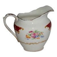 Canterbury Creamer by Royal Albert Reg. No. 832881.
