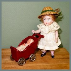 "4"" All Bisque Doll with Kilgore Carriage & Baby"