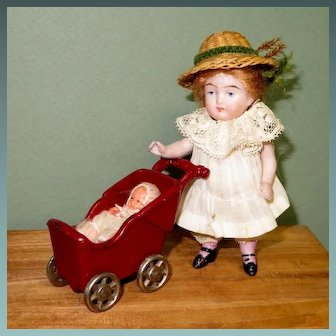 """4"""" All Bisque Doll with Kilgore Carriage & Baby"""