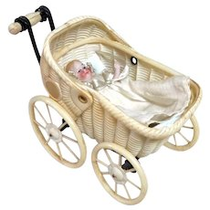 Early German All Bisque Baby with Yellow Boots In Celluloid Carriage