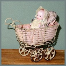 "2 3/4"" All Bisque Baby with Bottle in Wire Carriage"