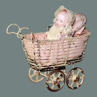 """2 3/4"""" All Bisque Baby with Bottle in Wire Carriage"""