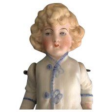 Antique All Bisque Doll with Molded and Painted Clothes