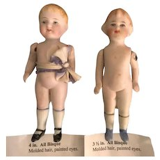 2 Antique All Bisque Dolls with Painted Features and Moveable Arms