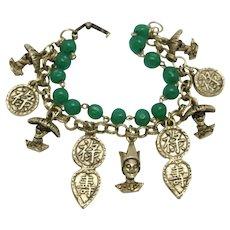 Charm bracelet gold tone metal Green glass beads Asian style