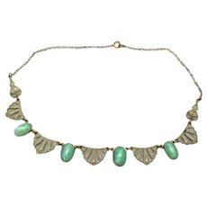 Green glass art deco necklace gold tone metal