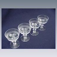 Four Kosta Clear Crystal Miniature Coupes
