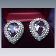 Boxed Pair of Ciner Clip Earrings, Faceted Amethyst Colored Marquis Surrounded by Pave Rhinestones