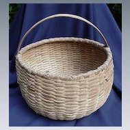 Antique Basket Made of Oak Splints with Bent Handle.
