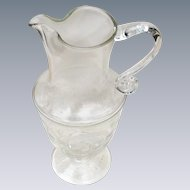 Stately Crystal Pitcher on Pedestal with Etched Scroll Design