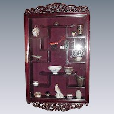 Vintage Asian Glass-Front  Display Cabinet with Carved Accents