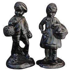 Plaster Figurines of Young Boy and Girl in 18th C. Costume