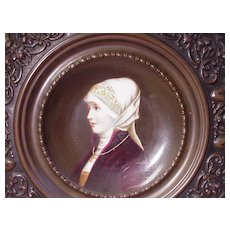 Porcelain Portrait Plate of Woman w Religious Symbols in Relief Frame