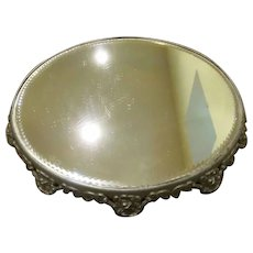 Early Round Plateau Mirror with Beveled Edge and Ornate Frame with Feet