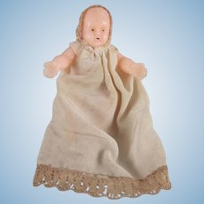 Hard Plastic Sitting Dollhouse Baby in Hat and Gown