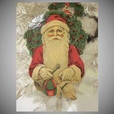 Early Germany Embossed Santa Diecut on a Net Candy Container Cone Bag Ornament