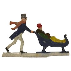 Made in Germany Hans Heinrichsen Christmas Winter Scene Flat Man Pushes a Woman in a Small Sleigh