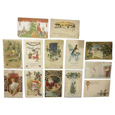 Early Group of 12 Christmas and One New Years Postcards