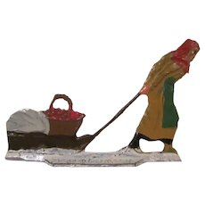 Made in Germany Metal Christmas Flat by Hans Heinrichsen of a Woman Pulling Apples on a Sled