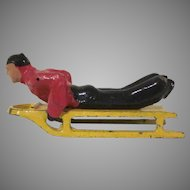 Vintage Barclay Man Sledding Christmas Winter Figure Two Pieces