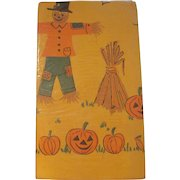 Reeds Rembrandt Line 54 x 96 Halloween Crepe Paper Tablecloth in the Original Package with Scarecrows and Jackolanterns