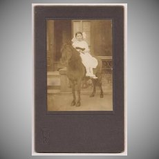 Cabinet Card of a Young Girl Sitting on a Horse