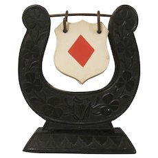 Early Plastic Horseshoe Shaped with Lyre and Clover Design Bridge Trump Indicator Marker