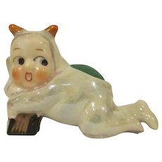 Made in Japan Glazed Bisque Lustre Child in a Devil Costume Pincushion