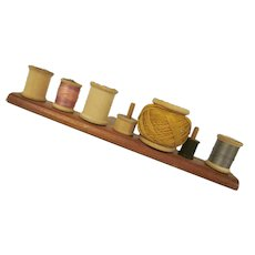 Wooden Spool Stand Holds Seven Spools with Early Wooden Spools of Thread Have 3