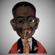 Made In Germany Black Americana Tin Litho Squeeze Toy Plays the Saxophone
