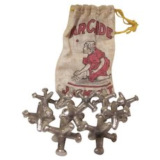 Early Cotton Bag of 10 Cast Iron Arcade Nickel Plated Jacks 1920s