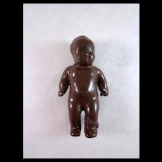 Brown Glazed Black Americana  Bisque Baby Doll for a Dollhouse