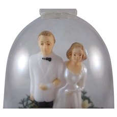 Hard Plastic Bride and Groom in Bell Cake Topper