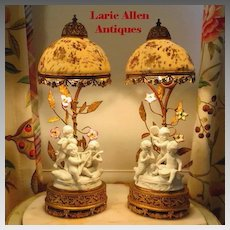 Rare pair French boudoir lamps with porcelain shades music boxes