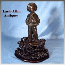 Reserved for K   Antique French bronze sailor boy on carved black forest base