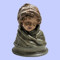 Cast Metal Bust of Child in Winter