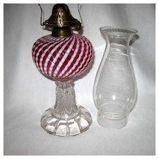 Cranberry Opalescent Sheldon Swirl Oil Lamp